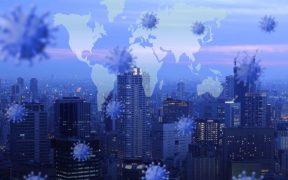 vista da cidade com icone de virus da covid