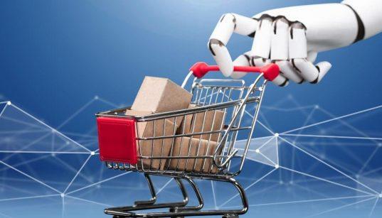 mao robotica segurando carrinho de supermercados